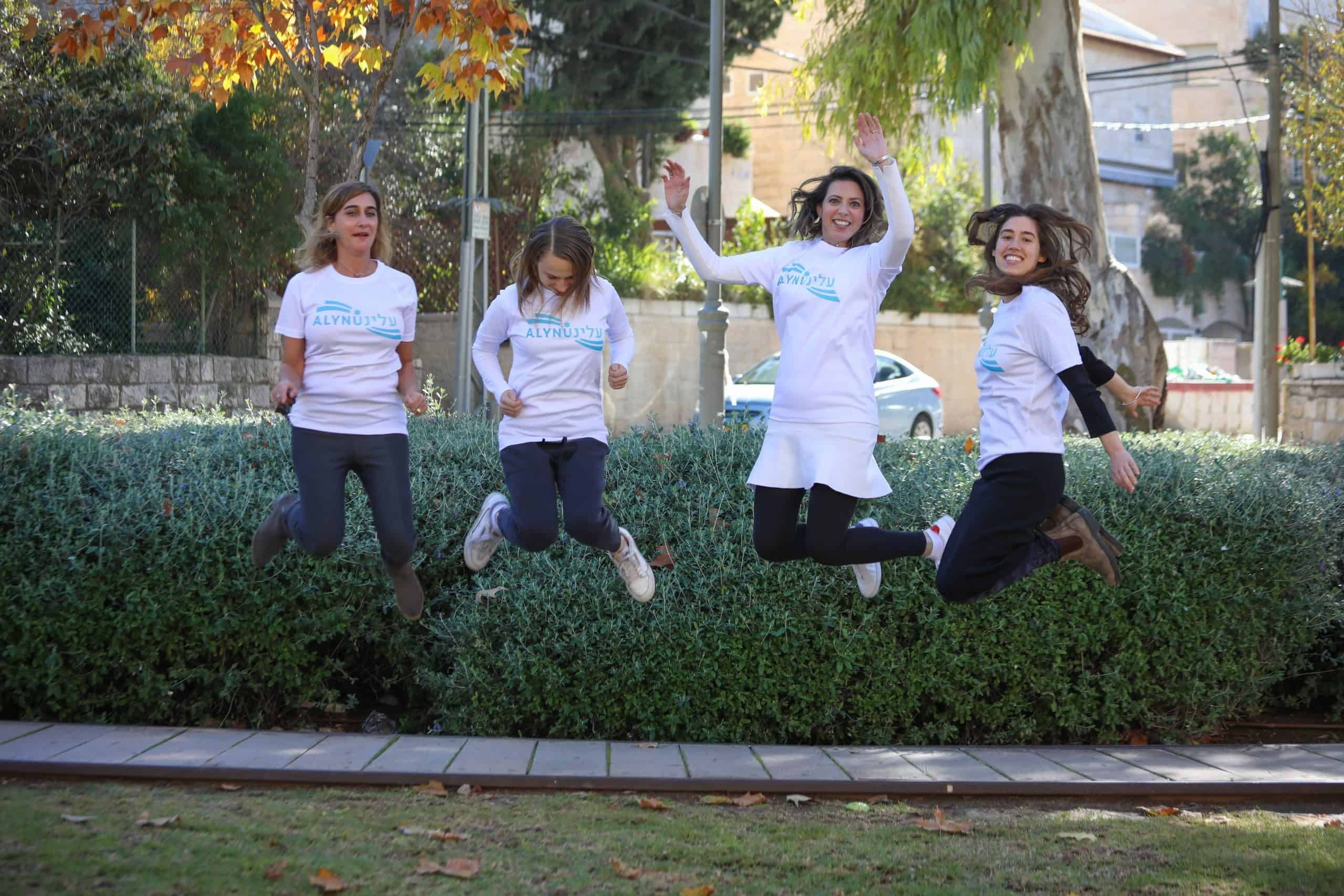 4 girls jumping in the air